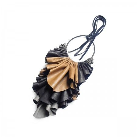 Mali Handmade Jabot in fine Italian leather. Adjustable fastening. Due to the uniqueness of each piece it requires at least 2 days from the day the order is placed.