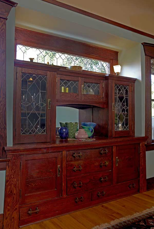 A Well Tended Bungalow by Sarah Hilbert. In the dining room, the built-in buffet has leaded-glass doors and rugged wood pulls. Great leaded glass!