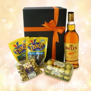 BELL'S BEST For the man who has everything. Surprise him on his special day with this stunning gift beautifully presented in a gift hamper box with tissue paper and ribbons   bottle of Bells whiskey Brazil nuts Beef biltong Dried wors 16 Ferrero Rocher chocolates