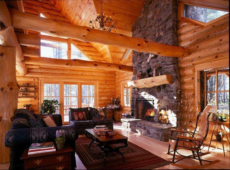 Log home living room offering plenty of windows. www.hiawatha.com