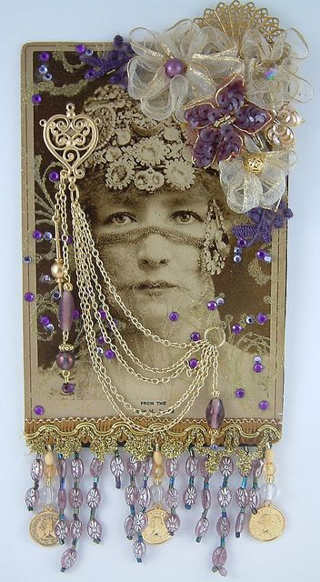 Hidden Beauty Altered Cabinet Card by Laura Carson  While I think this is freaking awesome, I really hope the cabinet card was reproduced. I think it would be a shame to do this to the original photo.