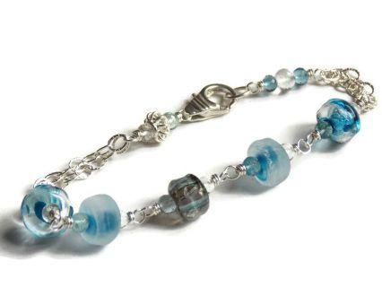Ocean Mosaic Bracelet! #lampworkglass #aquamarinegems #bluebracelet #sterlingsilverjewelry #handmadejewelry