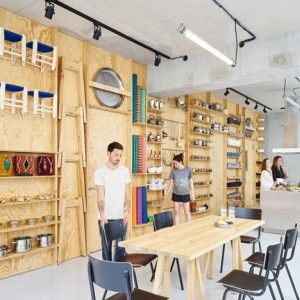 Tools and furniture hook onto a plywood wall in Paris cookery classroom by Septembre