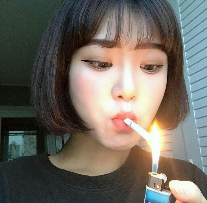 Asian girls smoking cigarettes, boy losing at strip