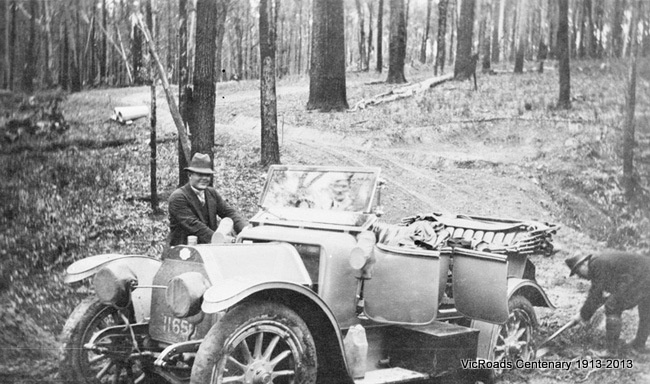 Country Roads Board's car in difficulties on newly formed and deviated road at Nowa Nowa-Buchan-Gelantipy Road 1913. VicRoads Centenary 1913-2013.