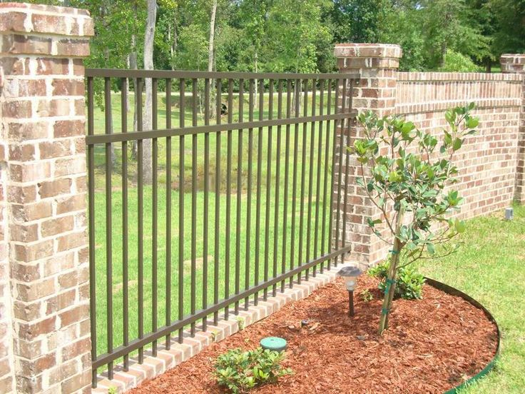 17 best ideas about iron fences on pinterest wrought for Brick and wrought iron fence designs