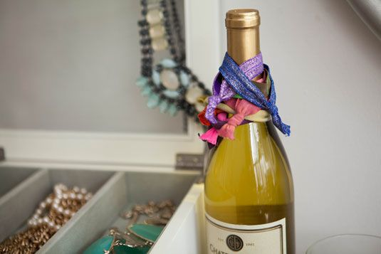12. Empty wine bottles can hold your hair bands //18 of the internet's BEST beauty storage hacks