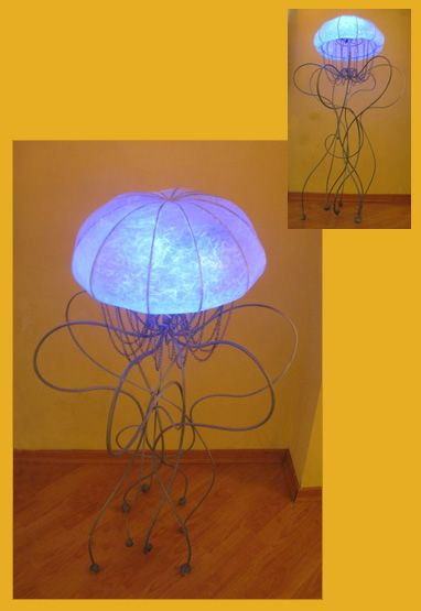 LaMedusa lamp. From the photos, it looks like these are made with metal and thick paper for the 'stained glass' parts.