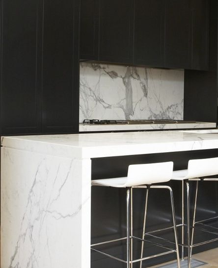 Marco Meneguzzi | marble benches and splash back with black cabinetry, luxe & modern!