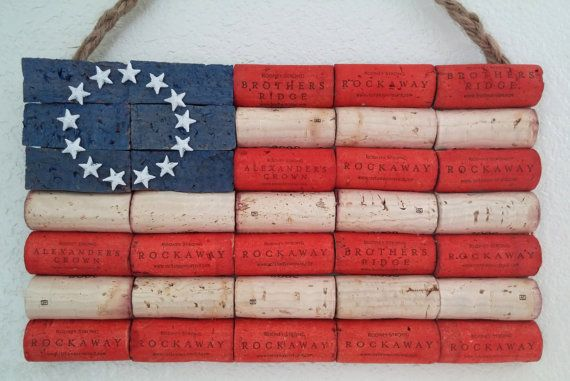 This listing is for a handmade UPcycled wine cork American Flag!  It has painted red stripes and 13 white plastic stars that rest on painted blue corks..for an authentic flag feel.  Item measures approximately 9.5 inches x 5.5 inches.  This item is glued together securely and hangs from a braided twine that is attached to the back.