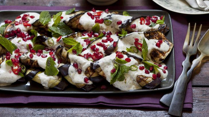 Grilled eggplant with tahini and yoghurt dressing, pomegranate, chilli and mint. This eggplant salad is great with barbecued meat or poultry, especially if there's a nice char on the flesh.