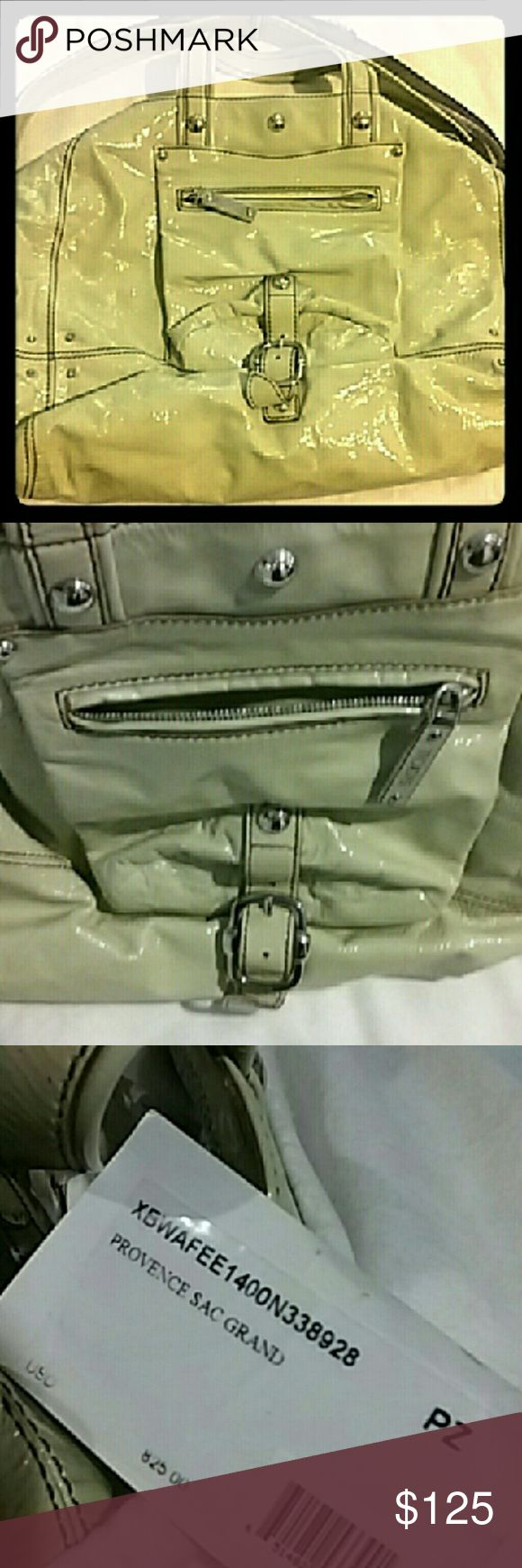 Shiny Tod's ivory hobo, like new! Shiny coated tote bag with multiple strap options by Tod's in off-white, see photos for exact shade. Signature chunky silver hardware, outside pocket with zipper and buckle, inside zip-pocket. Lining is in lavender emblazoned with Tod's logo. Never used, comes with dust bag, and original tag with price. See second post for more photos. Tod's Bags Hobos