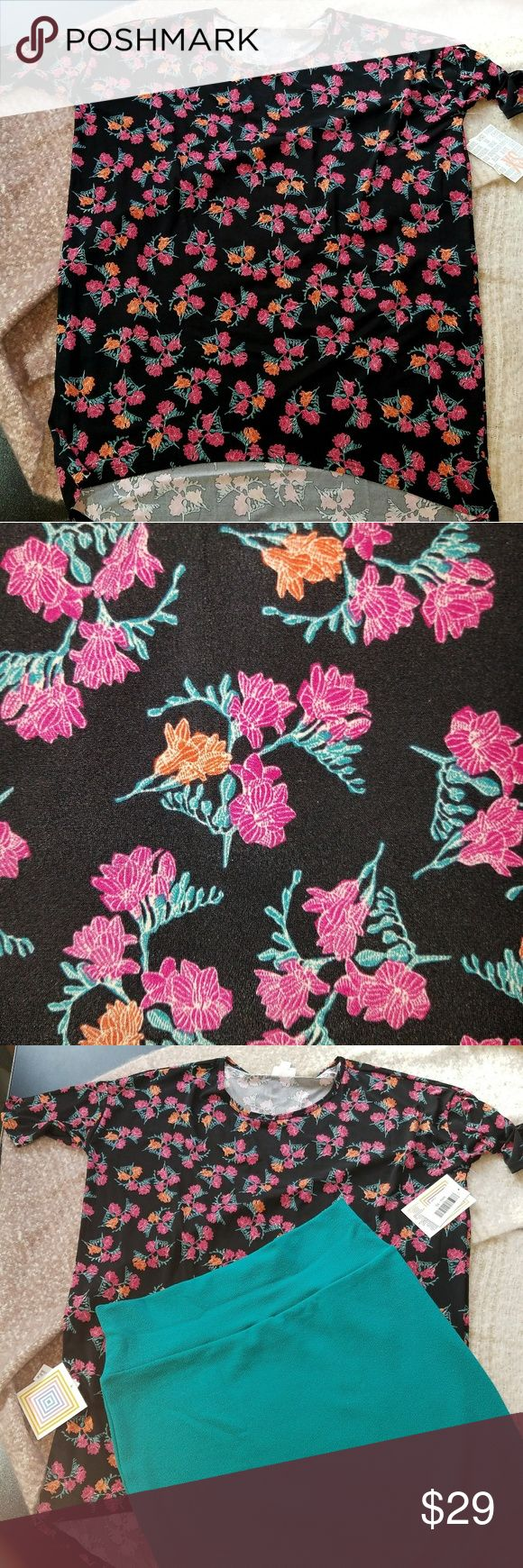 NWT Lularoe Irma black floral silky material This Irma is made of the slinky material. It's so soft and comfortable, and you can see by the photo of me wearing it on my size 12 body with an XL Cassie pencil skirt, the Irma runs pretty big, so keep that in mind. Desirable floral print. LuLaRoe Tops Blouses
