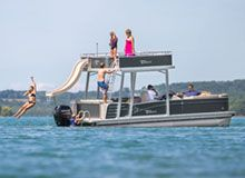 Double decker pontoon boats from Tahoe provide all the space your friends and family need for a day of fun on the lake. Sunbathe or slide from the upper deck and enjoy the shade, cruising from the lower deck. « View All Pontoon Models  Vision Funship Vision is the most revolutionary pontoon available. Featuring... Read more »