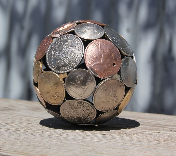 Mini mixed world coin ball, Coin sphere, Metal sculpture ornament. $55.00, via Etsy. I want one for every country I've been to (and will go to!)