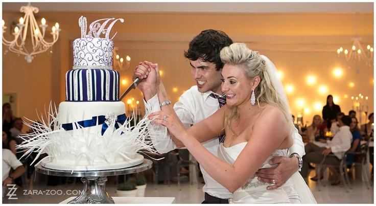 A three #tiered #cake with #monograms on the top and over the top decor elements at the bottom.  Make every tier a different flavour cake to have a variety.  This cake was made by Wades Cakes.  See more of this wedding at #Kleinevalleij on the #ZaraZoo Blog http://www.zara-zoo.com/blog/wedding-at-kleinevalleij/.