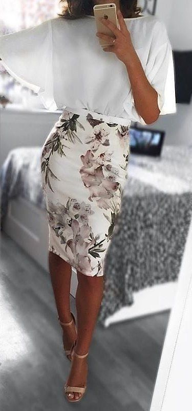 floral pencil skirt and flouncy top balance eachother out for the perfect work outfit