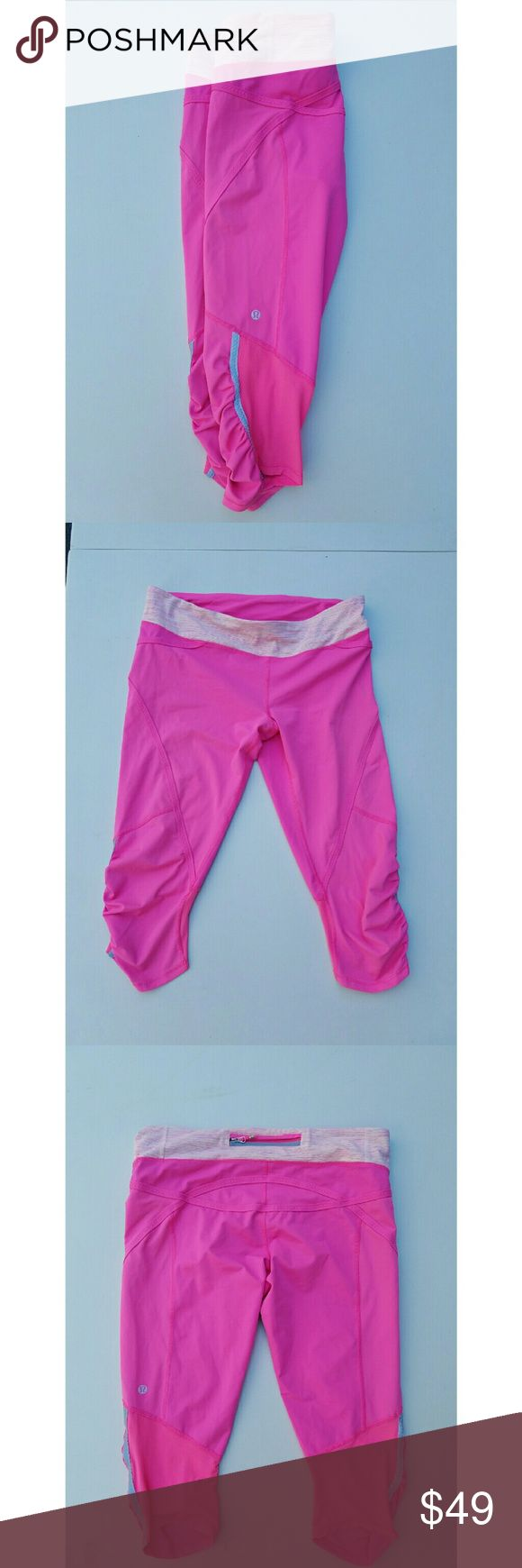 Lululemon Run Pace Crop the wee are from space  10 Preowned pair of Lululemon Run Pace Crop in a bright pink color with the wee are from space waistband  Mesh fabric on back of bottoms 3 pockets on waistband (rear one has a zipper) and a drawtape  Reflective strips on sides of legs   Very good preowned condition few minor snags in fabric as pictured lululemon athletica Pants Track Pants & Joggers