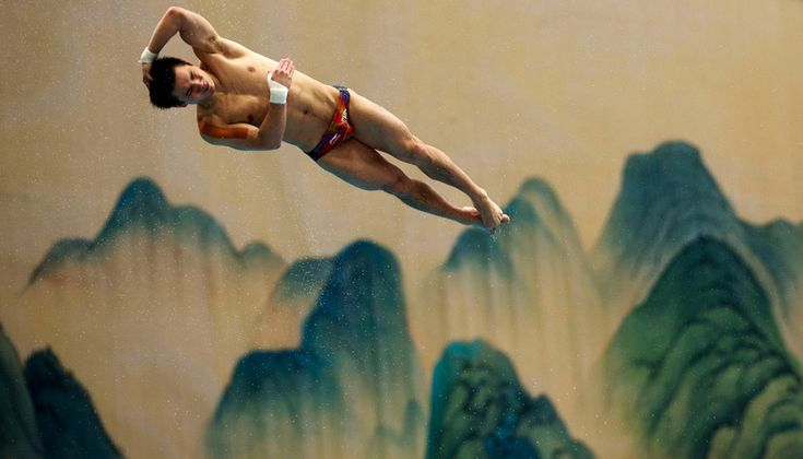 Qiu Bo dives during a training session prior to the FINA Diving World Series competition in Beijing, China
