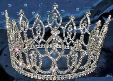 Magnificent rhinestone FULL CROWN made with the finest rhinestones and silver plated metal. DIMENSIONS: 4 inches tall 6.5 or 7 inches inches wide FULL CROWN Perfect for a beauty pageant, prom or home
