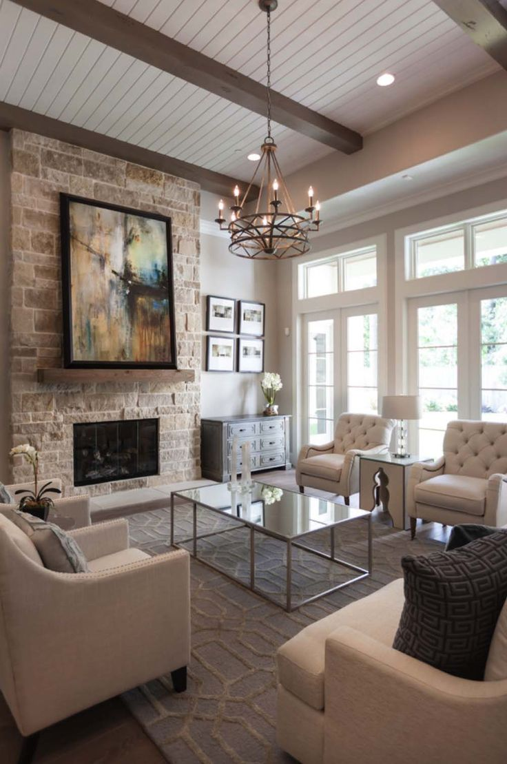 This warm and inviting transitional style home was designed by Frankel Building Group, located in the Woodlands Reserve, in Houston, Texas.