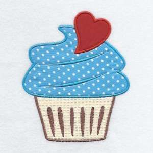 This free embroidery design from Embroidery Machine Designs is a cupcake.