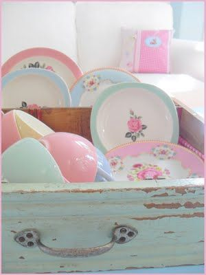 So pastel and pretty! dishes in a drawer