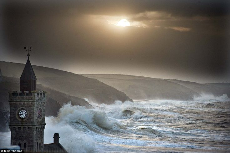 Splash: Porthleven in Cornwall today. Britain was again being battered by strong winds and large waves today as coastal communities braced f...