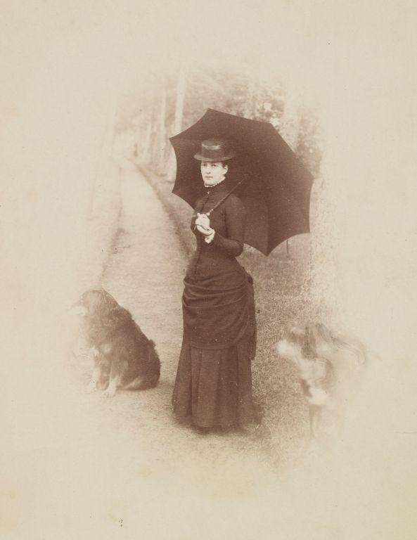 Portrait photograph of the Princess of Wales (1844-1925), later Queen Alexandra with two dogs, c. 1880 | Royal Collection Trust