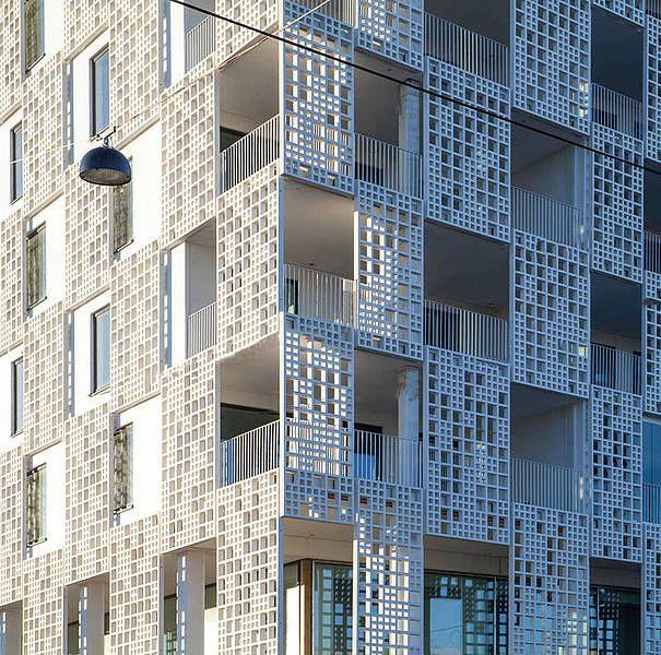 Thats concrete. yes. those panels with squares punched out. concrete. fibreC by Rieder - fibreC freeform
