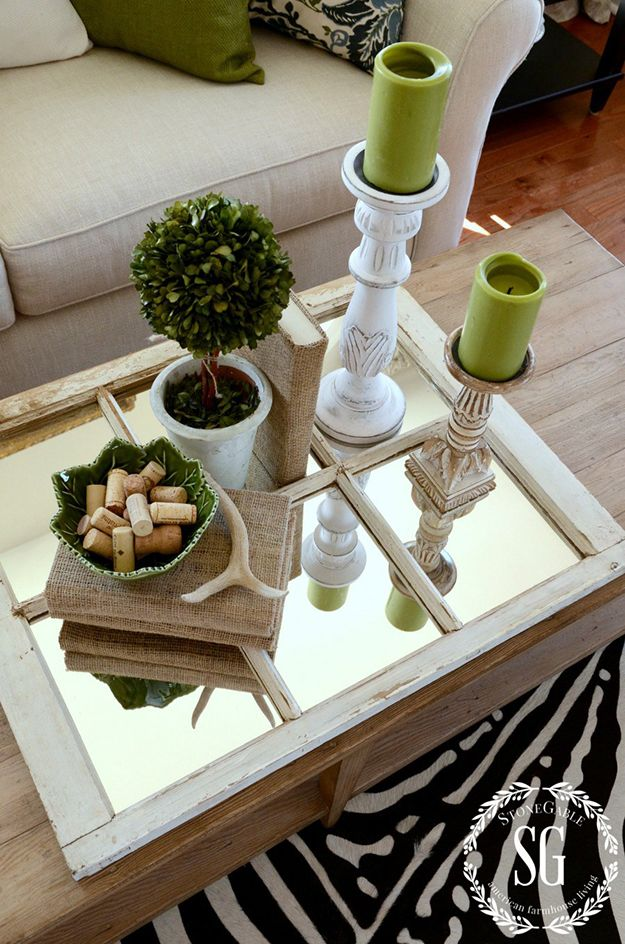 This is such a simple idea and would work perfectly on any of our rustic coffee tables. Using a small paned mirror or a small vintage window frame with mirrored inserts, use it as a tray on your coffee table to add dimension. Arrange a selection of display objects on top and consider adding a few candles as well to bounce that flicker around your space. Simple as well as pretty!