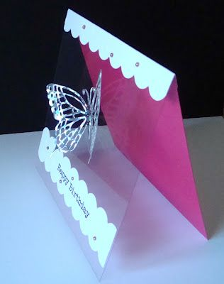 By Shirley. Butterfly cut from holographic paper. Card front uses acetate. What if you stamped a background of flowers on the cardstock base?
