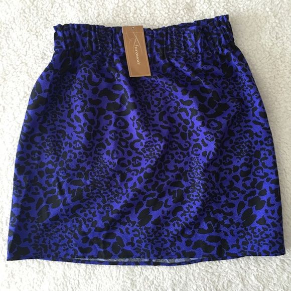"""Francesca's Animal Print Skirt Cinched waist and color is purple with black animal print. """"SYLACAUGA ANIMAL PRINT SKIRT"""" 18 inch skirt. 100% polyester. Great for the spring and summer and can be worn with tights for fall and winter! [Photo courtesy of: francescas.com] Francesca's Collections Skirts"""