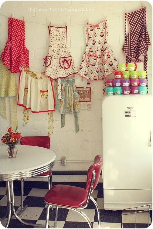 Aprons, old table and fridge