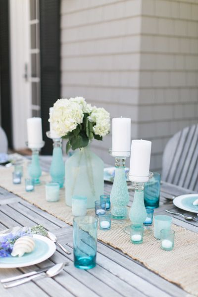 Seaglass inspired tablescape from Pier 1: http://www.stylemepretty.com/living/2015/05/21/a-seaglass-inspired-tablescape-with-pier-1-imports-diy-ombre-votives/ | Photography: Ruth Eileen - http://rutheileenphotography.com/