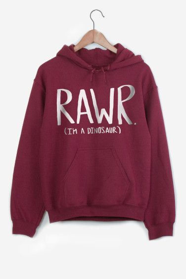 Maroon sweatshirt hand-printed. American cut with hood and front pocket. Crew neck, fitted shoulders and sleeves, ribbed trim and tightening at wrists. Ultra soft and comfortable inside.   Rawr Dinosaur by Leah Flores for R