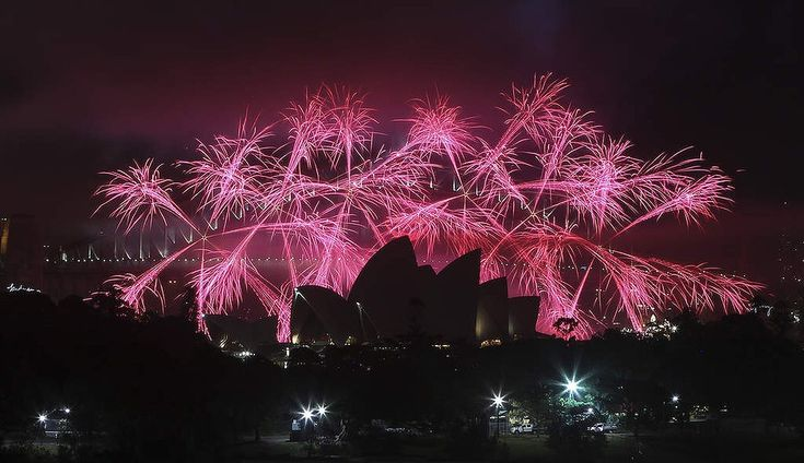 Fireworks explode behind the Opera House during the New Year celebrations in Sydney.