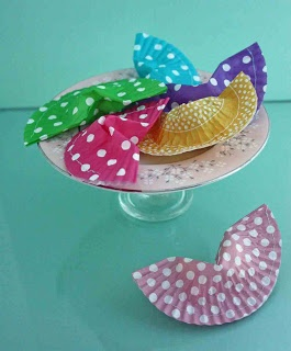 Cupcake liner fortune cookies: put in candy & a fortune & stitch shut.  NOTE - could also just use these to **wrap***pre-made***fortune cookies individually