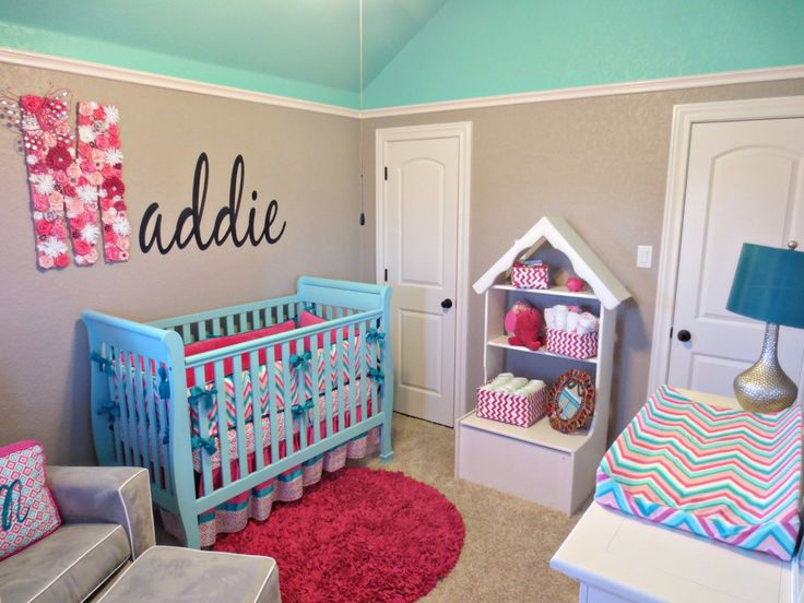 Brylees room all her decor is turquoise, hot pink & gray I think gray walls with a gray/white stripe accent wall and some pink & turquoise Pom poms, a cute little sheer canopy drape down from the ceiling will all look beautiful.