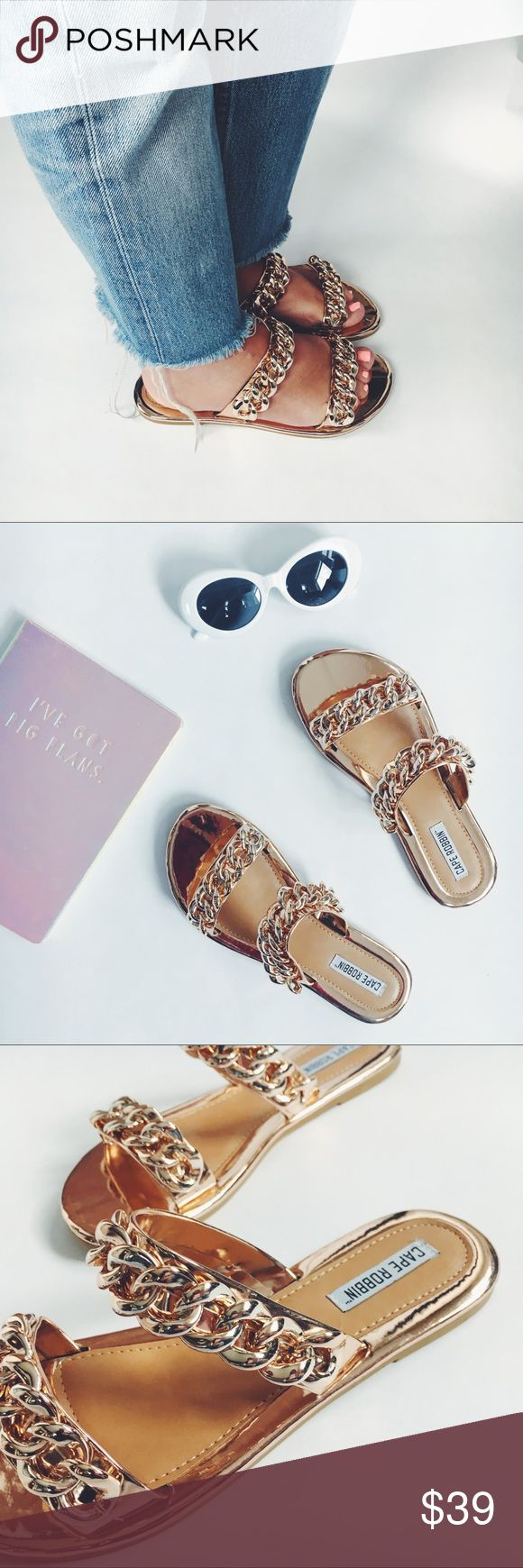 Sofia Rose Gold Metallic Chain Link Slides Mules New Boutique Item. The Sofia Sandal Slides feature chain link detailing, a rose gold metallic color, vegan material, and a slip on silhouette! Silhouette: Sandals, Mule, Slides, Flats. Heel: 0.5 inches. Width: Medium (B,M). Comes with box.True to size! Super Comfy + Chic!! Obsessed with these! Also available in Black with a silver Chain! Shoes Flats & Loafers
