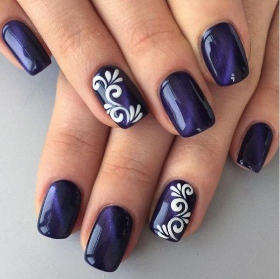 Gorgeous dark blue nails with white nail art