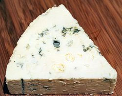 Danish Blue (also known as Danablu) is a strong, blue-veined cheese. This semi-soft creamery cheese is typically drum or block shaped and has a white to yellowish, slightly moist, edible rind. Made from cow's milk, it has a fat content of 25–30% (50–60% in dry matter) and is aged for eight to twelve weeks.