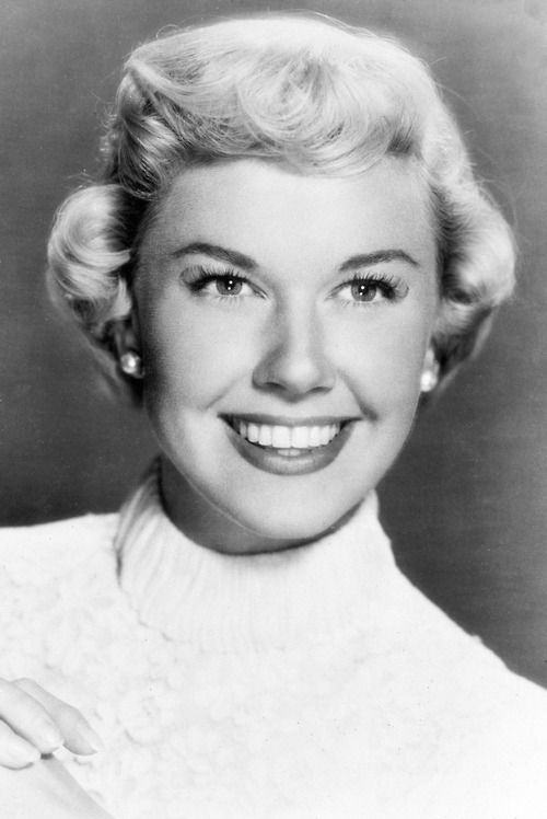 """Doris Day - Doris Day, the quintessential all-American girl, continues to be revered by her fans, while the media still celebrate her as an actress and singer with a legendary Hollywood """"girl next door"""" image. Her website: http://www.dorisday.com/about Also information here: http://www.imdb.com/name/nm0000013/bio"""