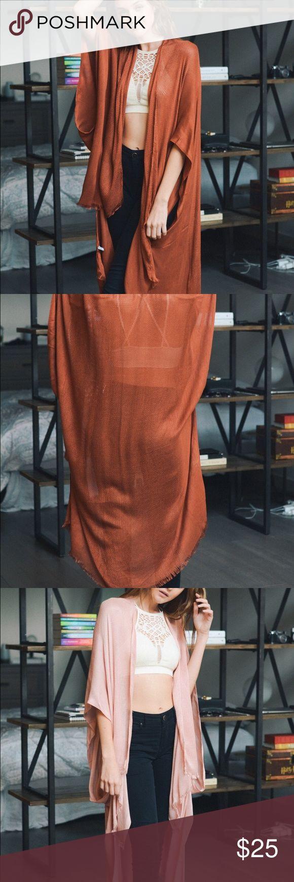 K I M O N O Open grid frayed trim kimono with armholes.  % viscose. Tops