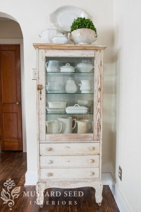 Dental cabinet with the original white chippy paint and a coat of a very pale blue/gray on the inside