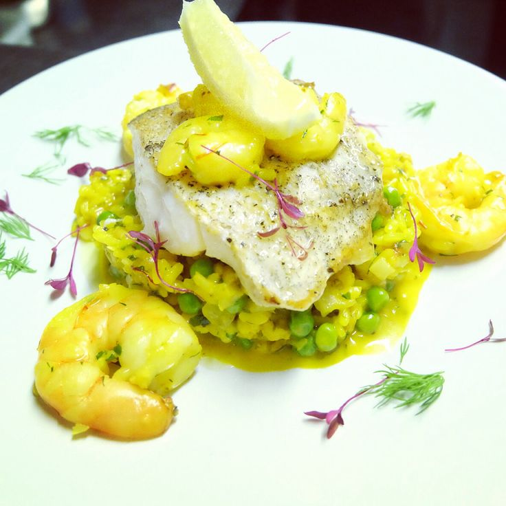 Tonight's special. Smoked haddock fillet served with a risotto of king prawns, shrimps, saffron and peas.