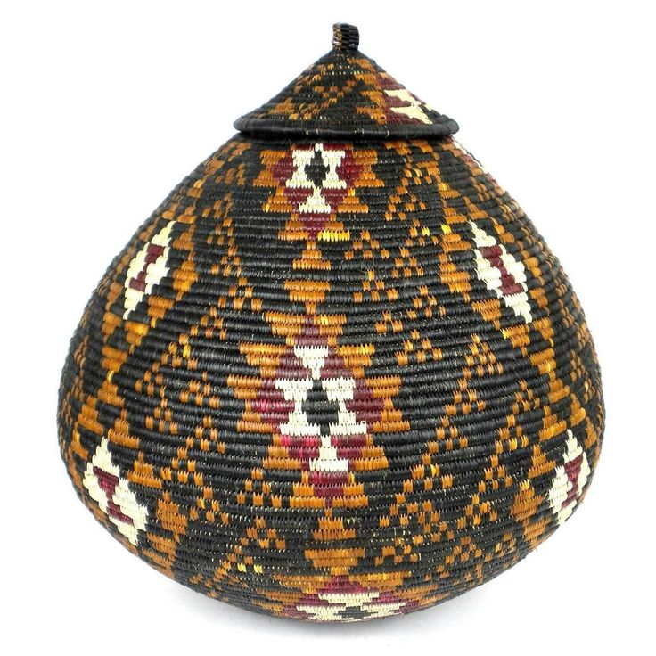 Fair Trade Handmade Zulu Wedding Basket - OS02 - Ilala Weavers - The Village Country Store   Traditionally woven to store beer, these baskets are handwoven in South Africa and often give as wedding gift. This basket with a tight-fitting lid is adorn with the traditional Zulu design in natural dyes. 19 inches tall x 57 inch diameter.