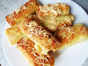 Фото к рецепту: Картофельные рулетики с мясом за 30 минут!