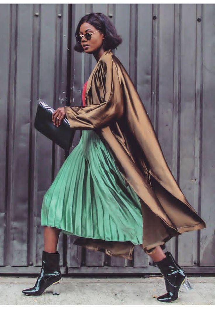 Brown silk coat with green silk pleated skirt.