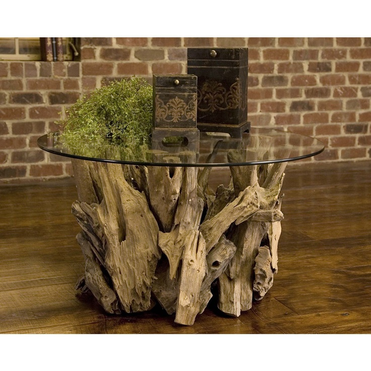 """The juxtaposition of this earthy Driftwood Coffee Table by Uttermost, #25519, with the brick wall behind it provides great contrast for this modern room. In our Kerrie Kelly Design Lab space, it provided the perfect amount of """"rustic"""" in a more luxurious space."""